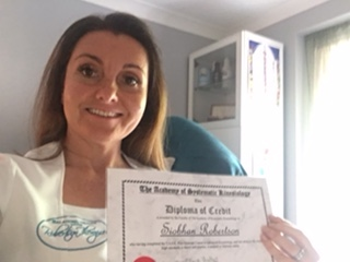 Image of Siobhan holding her diploma certificate